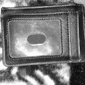 Card holder with pouch to hold change/money.